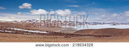 Panoramic view of holy Rakshas Tal lake in Ngari, Western Tibet, China. This lake also known as Demons Lake Ravana Tal or Ravan Harda in Hindu Religion.