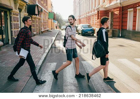 urban teenage hipster street lifestyle. students go to college or high school to study. crosswalk traffic laws concept