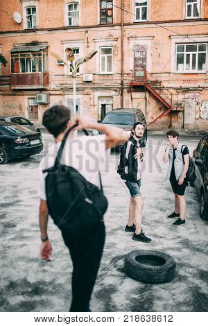 careless teenagers hang out together after school. urban street youth lifestyle. Free time leisure communication friendship concept