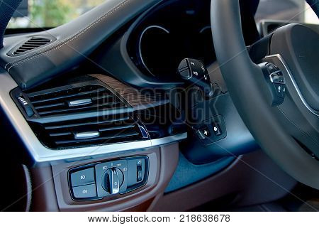 Detail of the headlight button in a car. transport concept - close up.