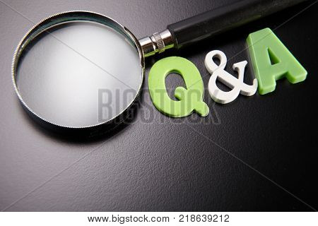 question and answer with magnifier on the black background