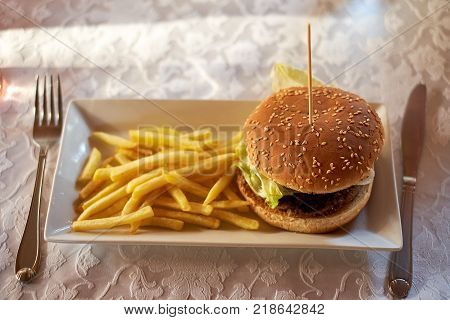 burger and french fries on the wooden table