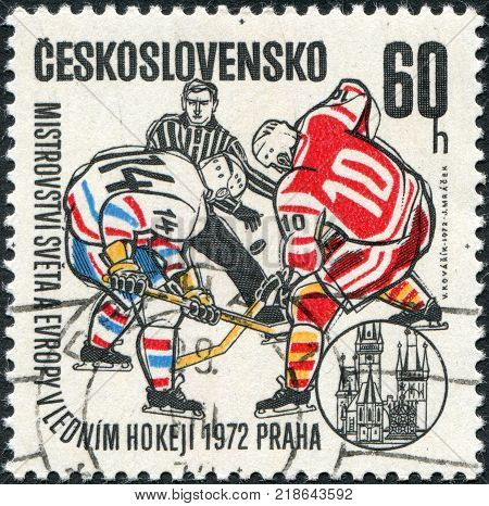 CZECHOSLOVAKIA - CIRCA 1972: A stamp printed in the Czechoslovakia dedicated to World and European Ice Hockey Championships Prague shows two hockey player and hockey referee circa 1972