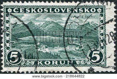 CZECHOSLOVAKIA - CIRCA 1927: A stamp printed in the Czechoslovakia shows the Great Tatra circa 1927
