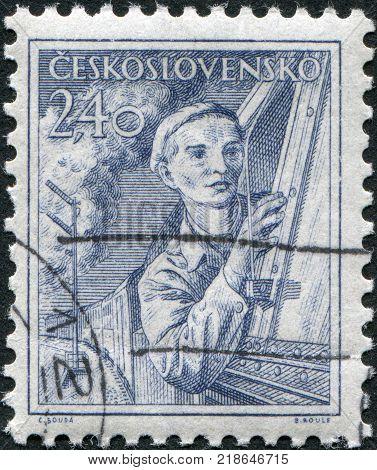 CZECHOSLOVAKIA - CIRCA 1954: A stamp printed in the Czechoslovakia shows a locomotive engineer circa 1954