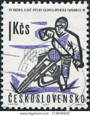CZECHOSLOVAKIA - CIRCA 1963: A stamp printed in the Czechoslovakia shows a motorcyclist competition