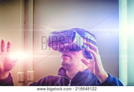 Double exposure of man wearing virtual reality over the abstract photo blurred background