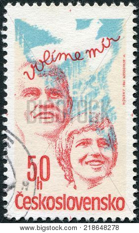 CZECHOSLOVAKIA - CIRCA 1981: A stamp printed in the Czechoslovakia is dedicated to socialist and democratic elections shows a man woman and a dove of peace circa 1981