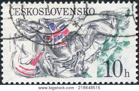 CZECHOSLOVAKIA - CIRCA 1978: A stamp printed in the Czechoslovakia Pardubice Steeplechase shown Falling horses and jockeys at fence circa 1978