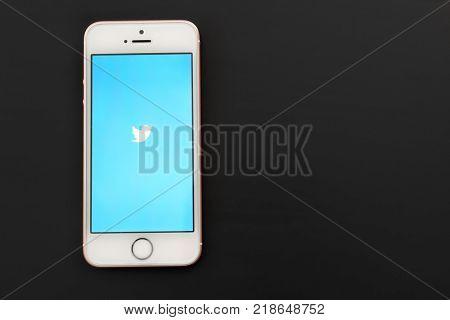 KIEV, UKRAINE - OCTOBER 17, 2017: Rose Gold iPhone SE with Twitter app on screen against black background