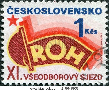 CZECHOSLOVAKIA - CIRCA 1987: A stamp printed in the Czechoslovakia is dedicated to the 11th Congress Revolutionary Trade Union Movement Prague shows a flag circa 1987