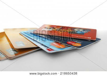 KIEV, UKRAINE - SEPTEMBER 26, 2017: Different MasterCard credit cards on light background