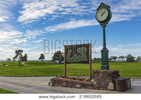 LA JOLLA CALIFORNIA USA - NOVEMBER 6 2017: The South Course sign and map beside the Rolex clock on the first tee of Torrey Pines golf course near San Diego.