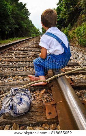 A Runaway Sitting Down Taking A Break