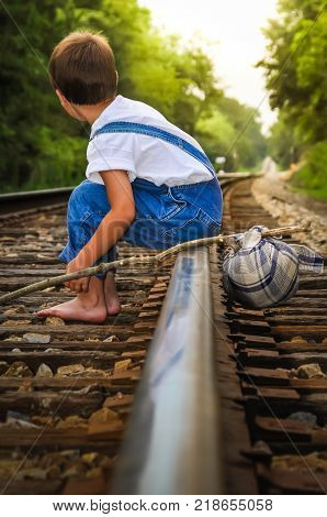 A Runaway Sitting On The Railroad Track