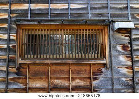 Kanazawa - Japan, June 11, 2017: Window with bars in a wooden two-story house in the historical Higashi Chaya District, Kanazawa City, Ishikawa Prefecture