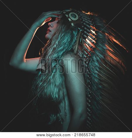 Faith, beautiful girl with plume of american indian feathers