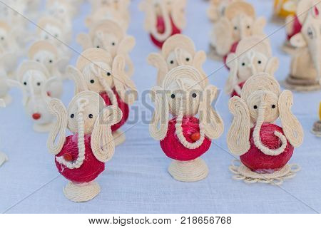Colourful dolls of Lord Ganesha artworks of handicraft made from jute at Handicraft Fair in Kolkata - the biggest handicrafts fair in Asia.