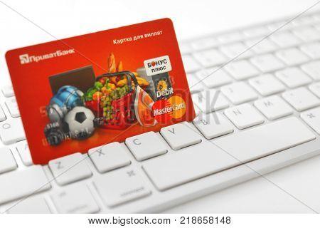 KYIV, UKRAINE - OCTOBER 02, 2017: MasterCard credit card on keyboard, closeup