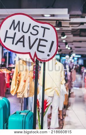 Must Have placard in the shopping mall. Fashion store sign.