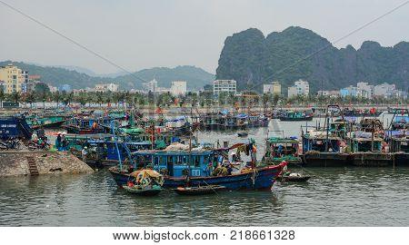 Quang Ninh Vietnam - May 23 2016. Fishing boats docking on Ha Long Bay in Quang Ninh Vietnam. Ha Long Bay is a UNESCO Site and popular travel destination.