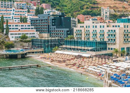 Budva, Montenegro - August 20, 2017: View of the modern beach town of Budva, Montenegro. Budva is one of the best and most popular resorts of the Adriatic Riviera. Beautiful beach on the Budva Riviera