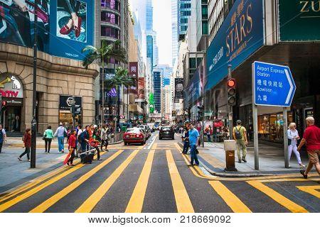 HONG KONG, CHINA - APR 4, 2016: Unidentified tourists walk by the street in Hong Kong on Apr 4, 2016, China.