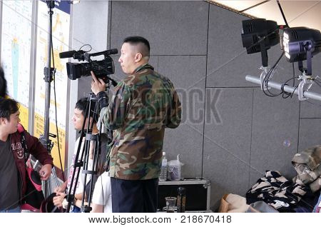 Taipei, Taiwan - December 02, 2017 : Top shot of video operator with camcorder on tripods recording video at an event