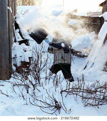 Boy shoveling snow. Boy, shovel and snow.