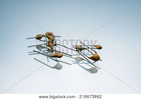 bipolar electric capacitors on white background. microelectronic components. construction of two electrodes