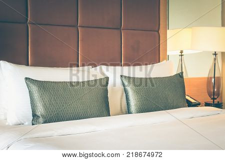 White pillows and grey pillows on bed in the luxury hotel.