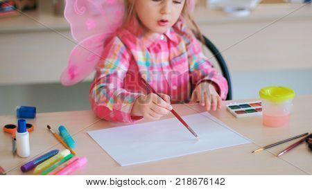 hardworking little cutie on art lessons. creative process. lifestyle of talented people.