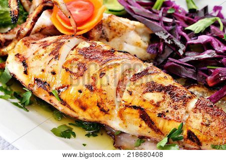 Grilled Greek Calamari with vegetables and tomatoes