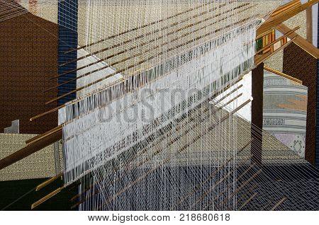 Traditional Thai silk hand weaving process in Thailand
