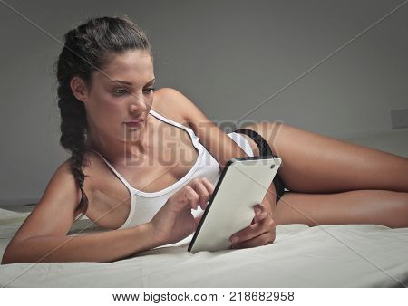 Fit girl using a tablet