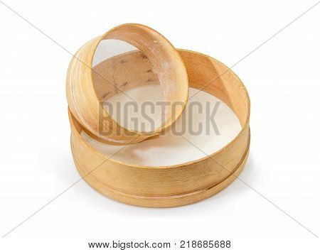 Two old round kitchen sieves different sizes with wooden frames and plastic mesh on a white background