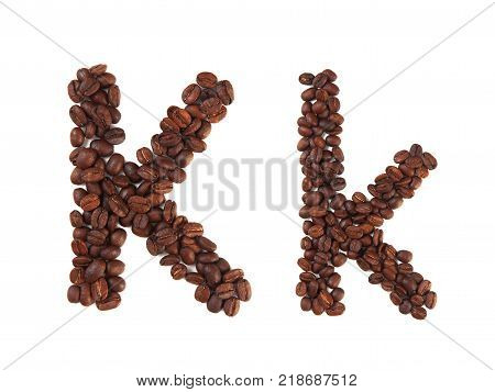 Letter K made of coffee beans isolated on white. Concepts: alphabet logo creative coffee hand made words symbols.