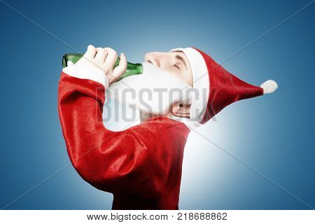 caricature of funny drunken santa claus drinking beer
