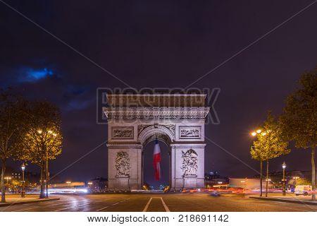 Paris Arc de Triomphe Triumphal Arch at Chaps Elysees at night, Paris, France. Architecture and landmarks of Paris.