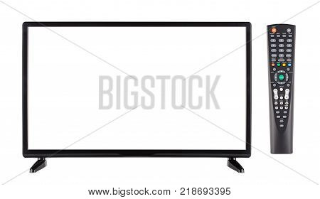 Front view of modern empty black flat screen TV and remote control isolated on white background