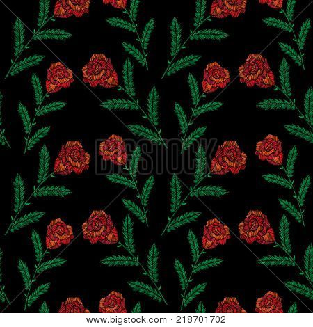 Seamless pattern with little embroidery stitches imitation red roses. Fashion embroidery rose flower on black background. Embroidery roses background