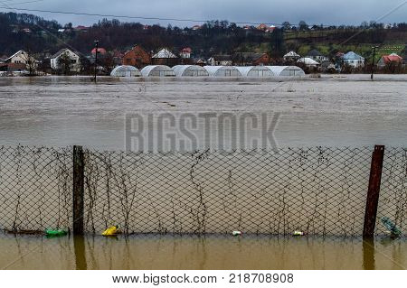 Syltse Ukraine - December 16 2017: Flooded rural lands and greenhouses during the winter flood near the village of Syltse.