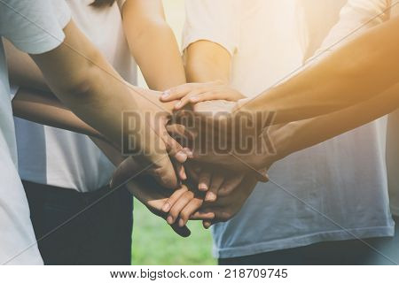 Team teamwork business join hand together concept Power of volunteer charity work Stack of people hand