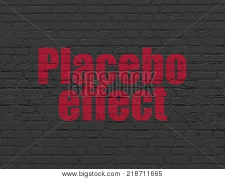 Healthcare concept: Painted red text Placebo Effect on Black Brick wall background