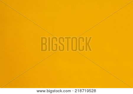 Yellow or ocher homogeneous background seamless surface