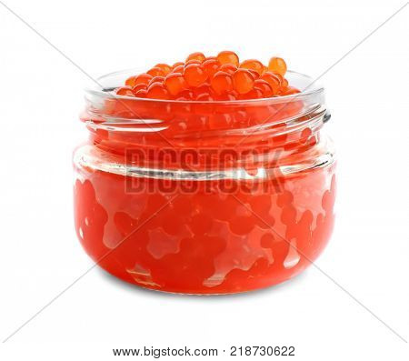 Delicious red caviar in glass jar on white background