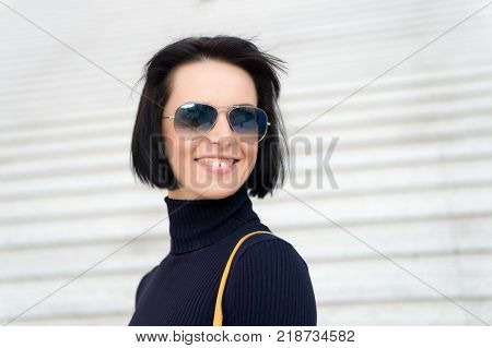 Ambition challenge success concept. Woman in sunglasses on stairs. Fashion and accessory. Girl with brunette hair in black clothes. Look beauty style. Parisian woman poster