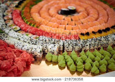 Delicios sushi rolls catering includes salmon, rice, seasame, wasabi, soy sauce and gari. Tamago, california, philadelphia futomaki maki