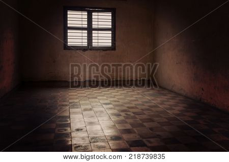 Phnom Penh, Cambodia - April 1, 2017: Tuol Sleng Genocide Museum in Phnom Penh, Cambodia. Emty room used as prison.