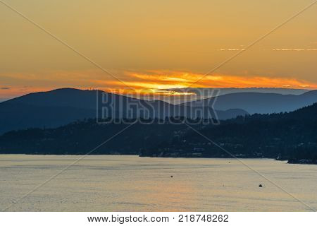 Sunset with Sea and Mountain View. Lions Gate Bridge Sunset and evening in Vancouver Canada.